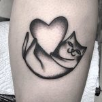Cat with a heart tattoo