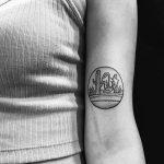 Circular desert landscape tattoo