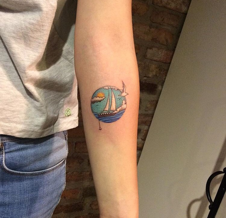 Circular ship in a sea tattoo