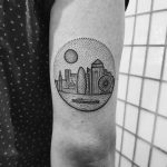 Circular tattoo of a city
