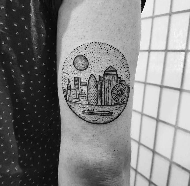Circular tattoo of a city