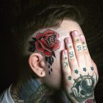 Classic rose tattoo on the head