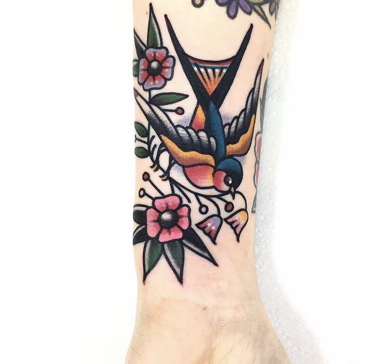 Classic swallow tattoo