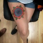 Colorful mandala on the right thigh