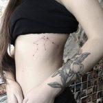 Constellation tattoo on the left rib