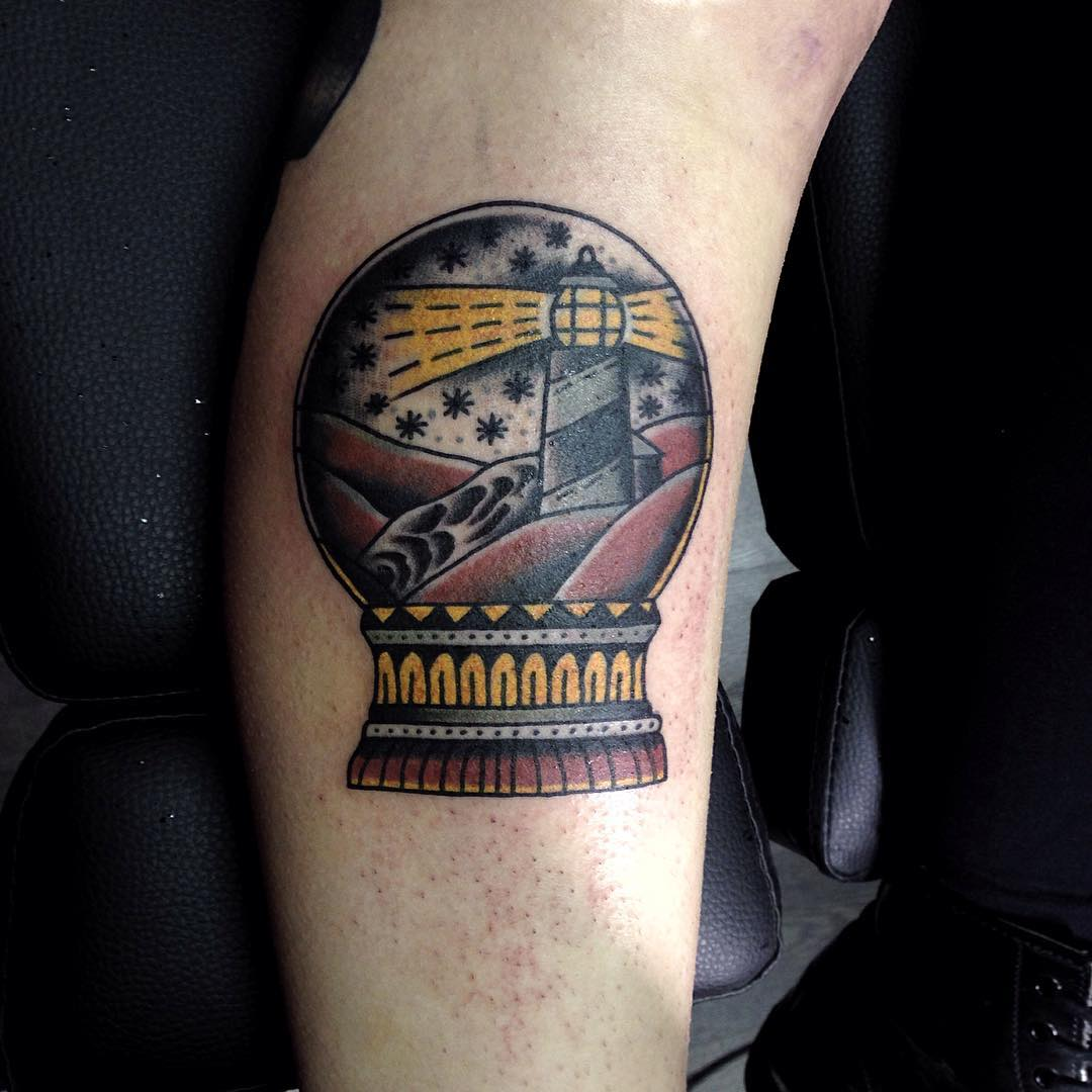 Crystal ball tattoo