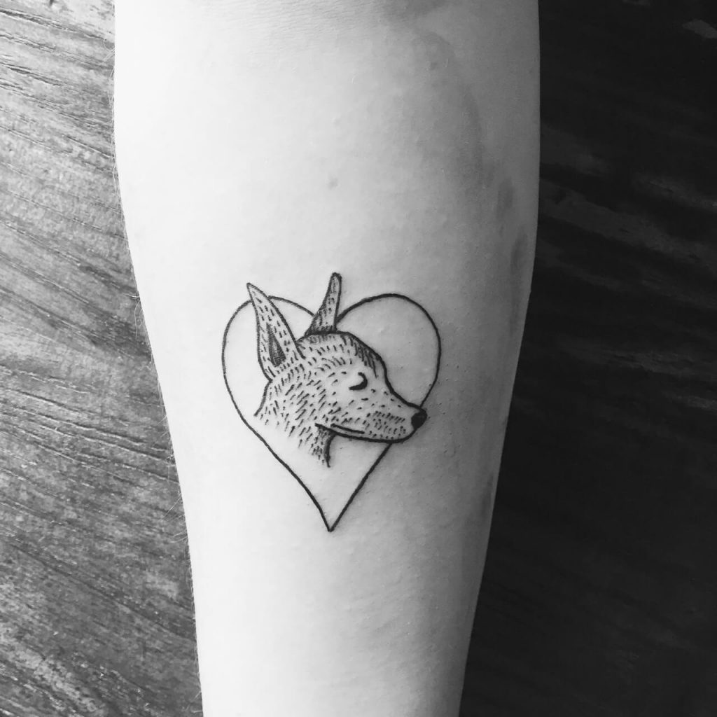 Cute dog in a heart tattoo