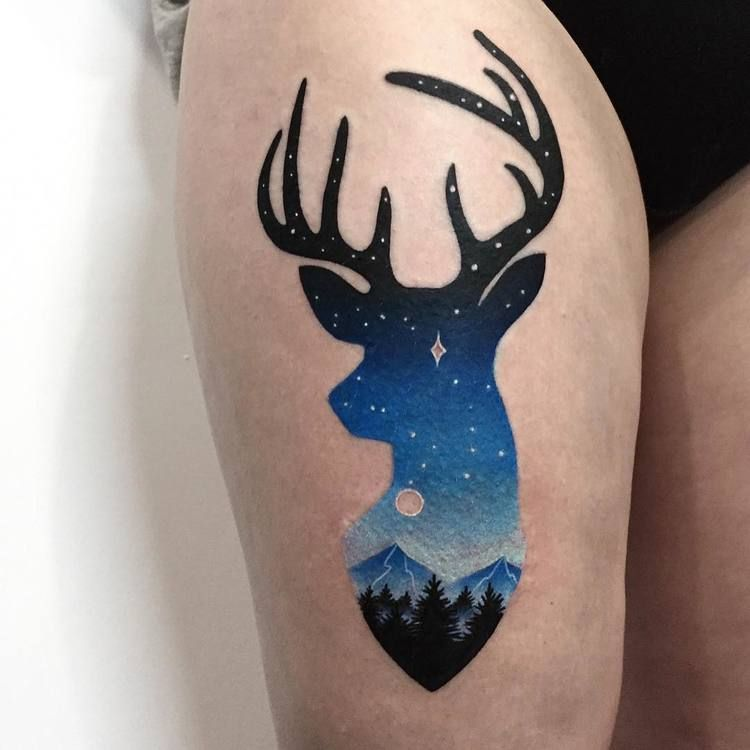 Deer tattoo on the thigh