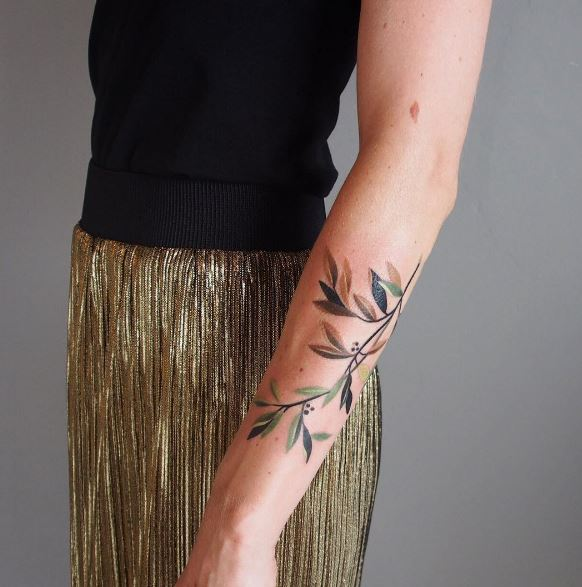 Delicate branch tattoo on the forearm