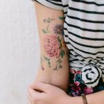 Delicate flowers tattoo on the arm