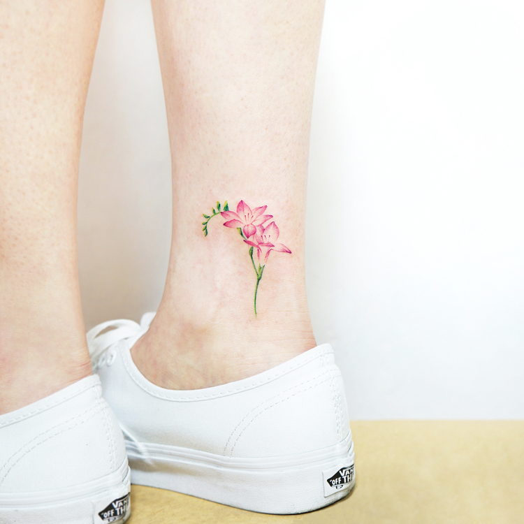 Delicate pink flower tattoo