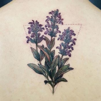 Delicate violet wildflowers tattoo on the back