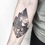 Desert landscape in a rhombus tattoo