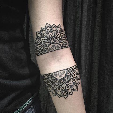 Divided mandala tattoo