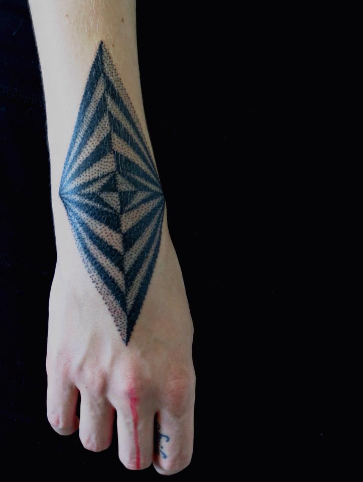 Dot work style geometric pattern tattoo