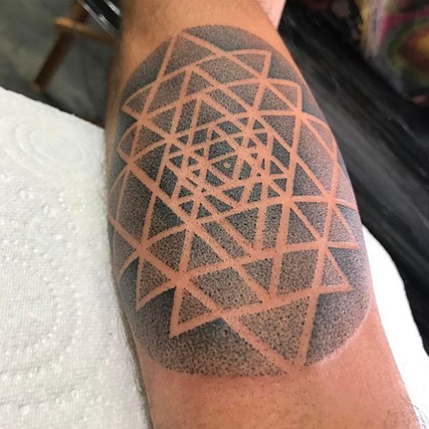 Dotwork sacred geometry tattoo on the arm