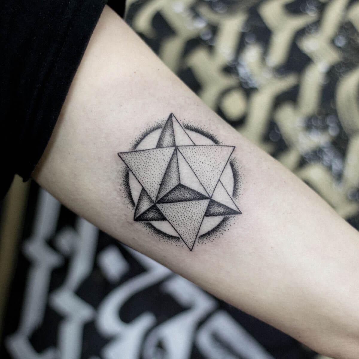 Dotwork style triangle tattoo