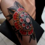 Elbow tattoo of a traditional mandala