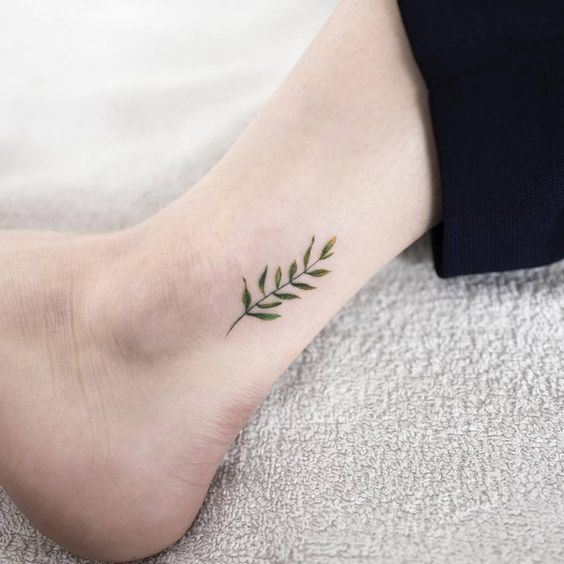 Fern leaf tattoo on an ankle