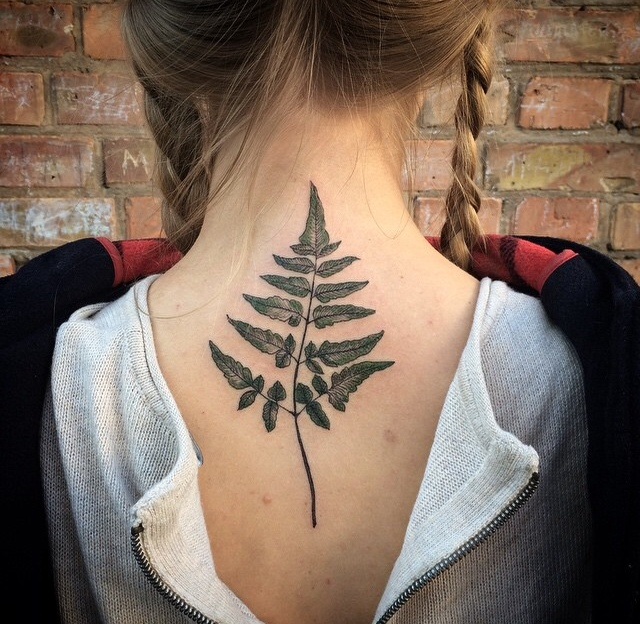 Fern leaf tattoo on the back
