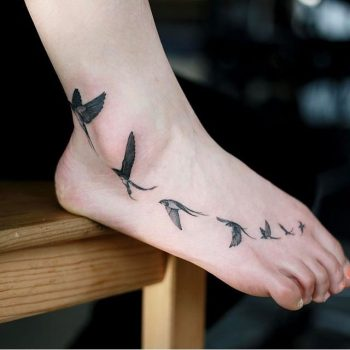 Flock of birds tattoo on the foot