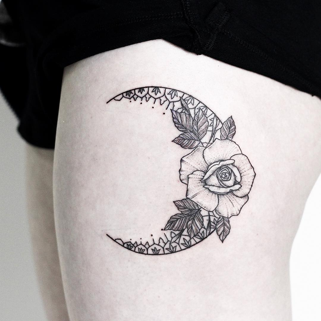 Floral crescent moon tattoo
