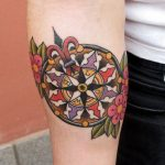 Floral mandala compass tattoo