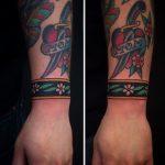 Floral wristband tattoo