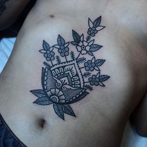 Flower in a pot tattoo