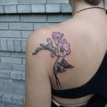 Flower tattoo on the left shoulder blade