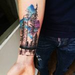 Forest and watercolor sky tattoo