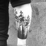 Forest scenery tattoo on the shin