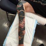 Full sleeve astronaut tattoo