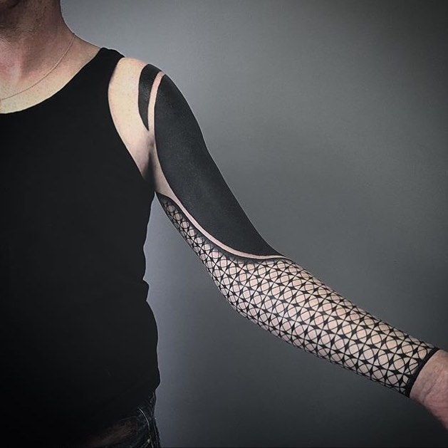 Full sleeve black geometric tattoo