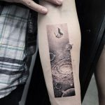 Galaxy landscape and a falling man tattoo