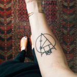 Geometric black linear tattoo on the forearm
