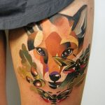 Geometric fox tattoo on thigh
