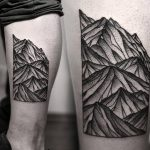 Geometric mountains tattoo on the shin