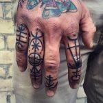 Geometric shapes finger tattoos