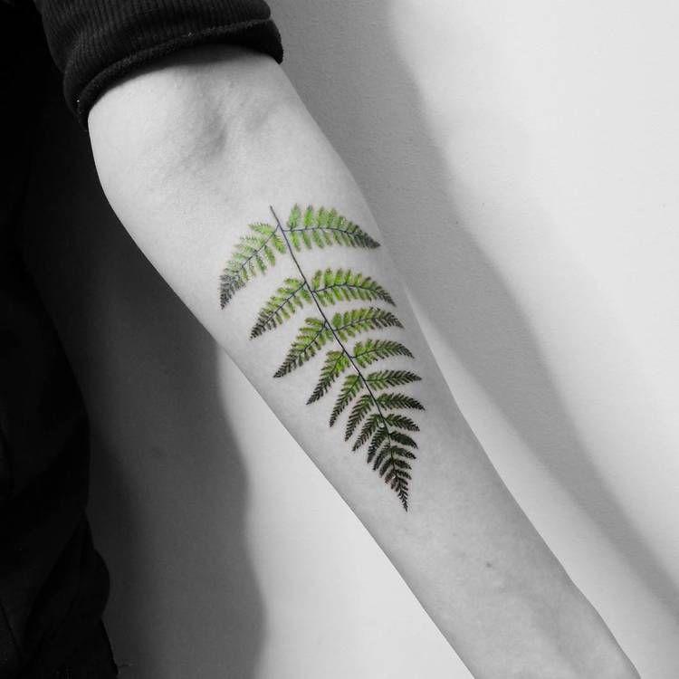Green fern leaf tattoo