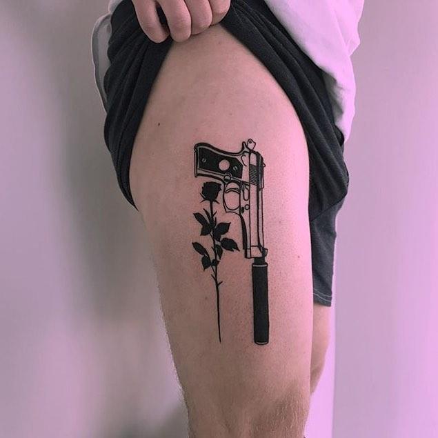 Gun and rose tattoo