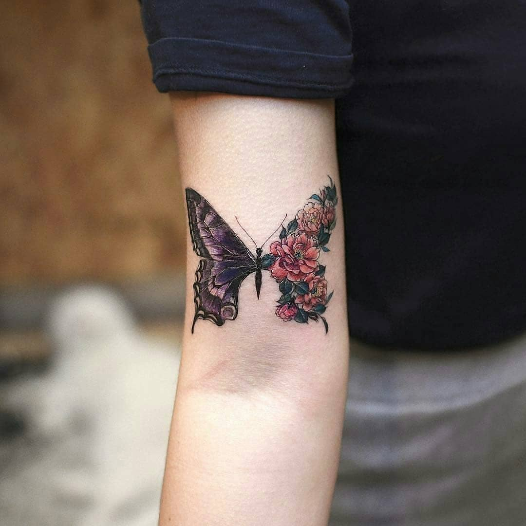 Half realistic half floral butterfly tattoo