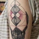 Half skull and geometric tattoo