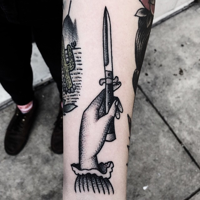 Hand and dagger tattoo