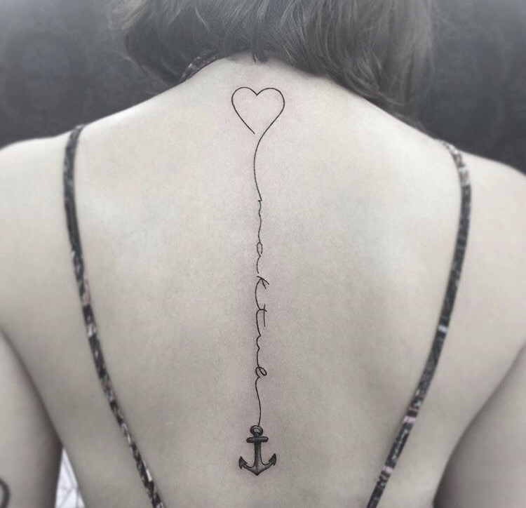 Heart and anchor tattoo on the back