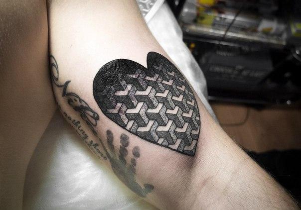 Heart shaped geometric pattern tattoo