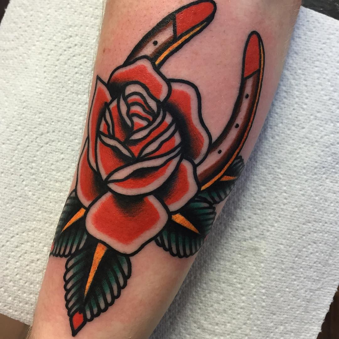 Horseshoe and rose traditional tattoo