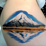 Hyper realistic mountain and reflection tattoo