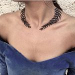 Laurel wreath tattoo around the neck