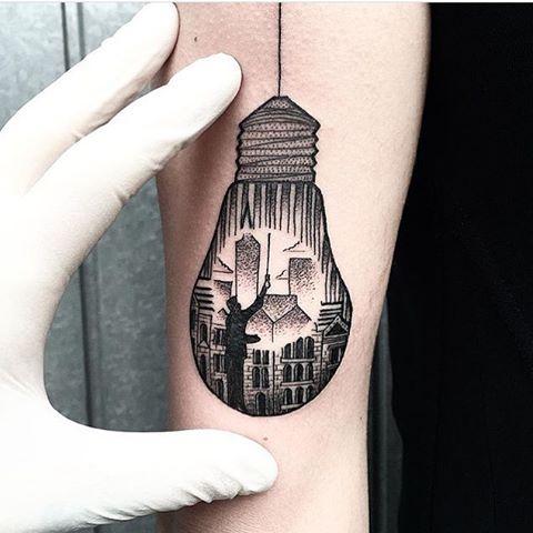 Lightbulb tattoo on the arm